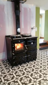 AGA black wood fired range.